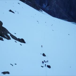 Hickers Climbing Snowy Mountain Dash